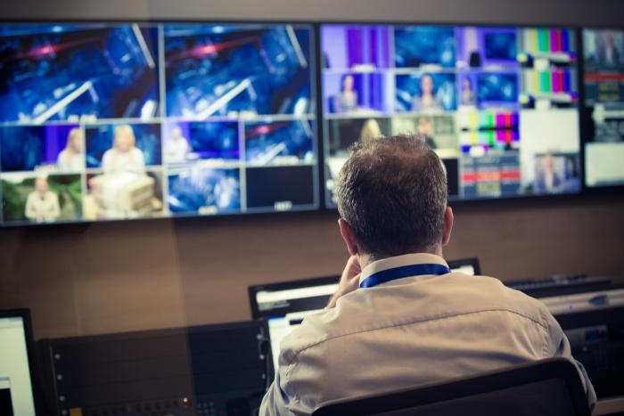 man watching screens in studio